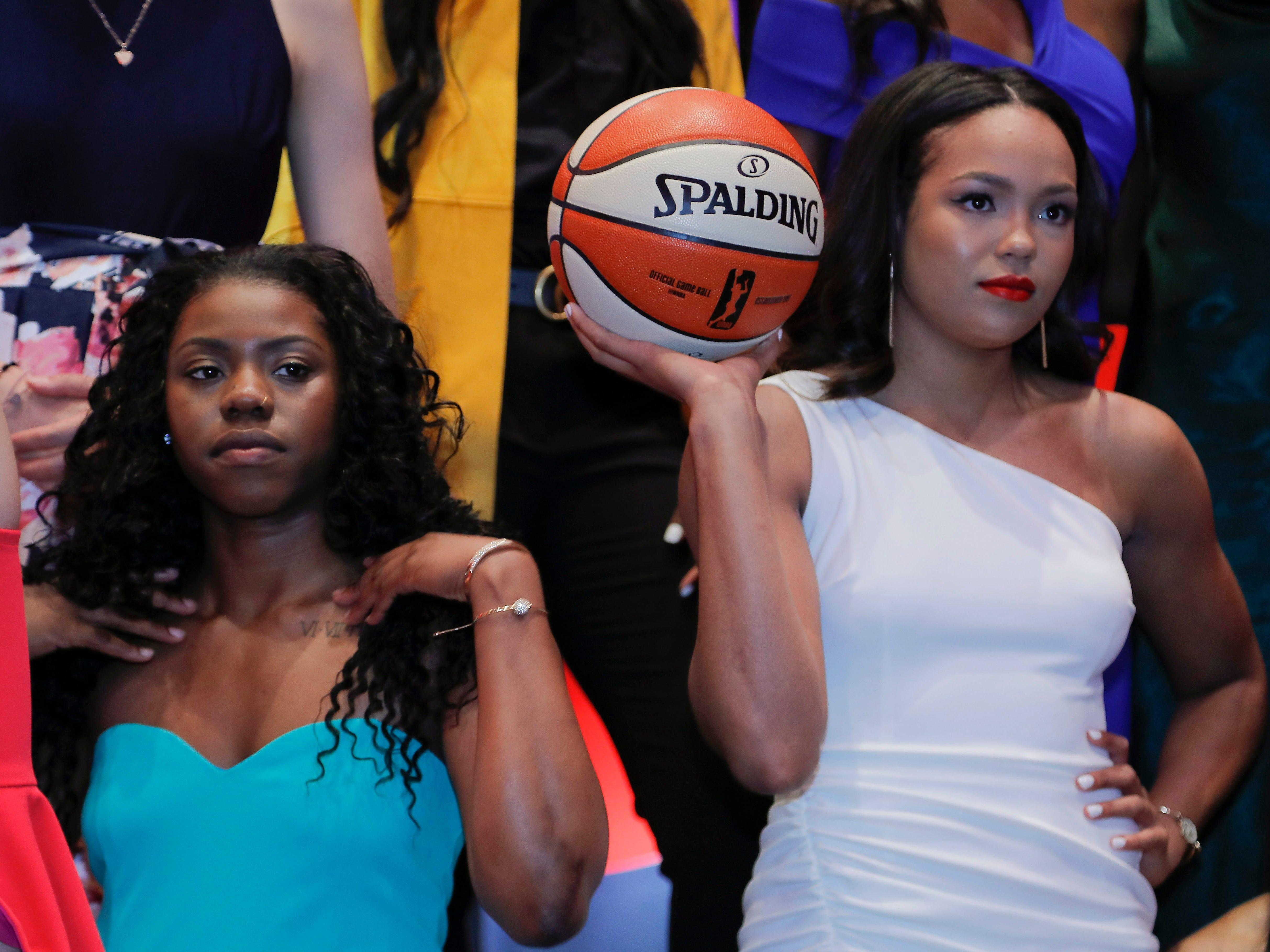 Arike Ogunbowale (left) and Napheesa Collier pose for photos before the WNBA draft.