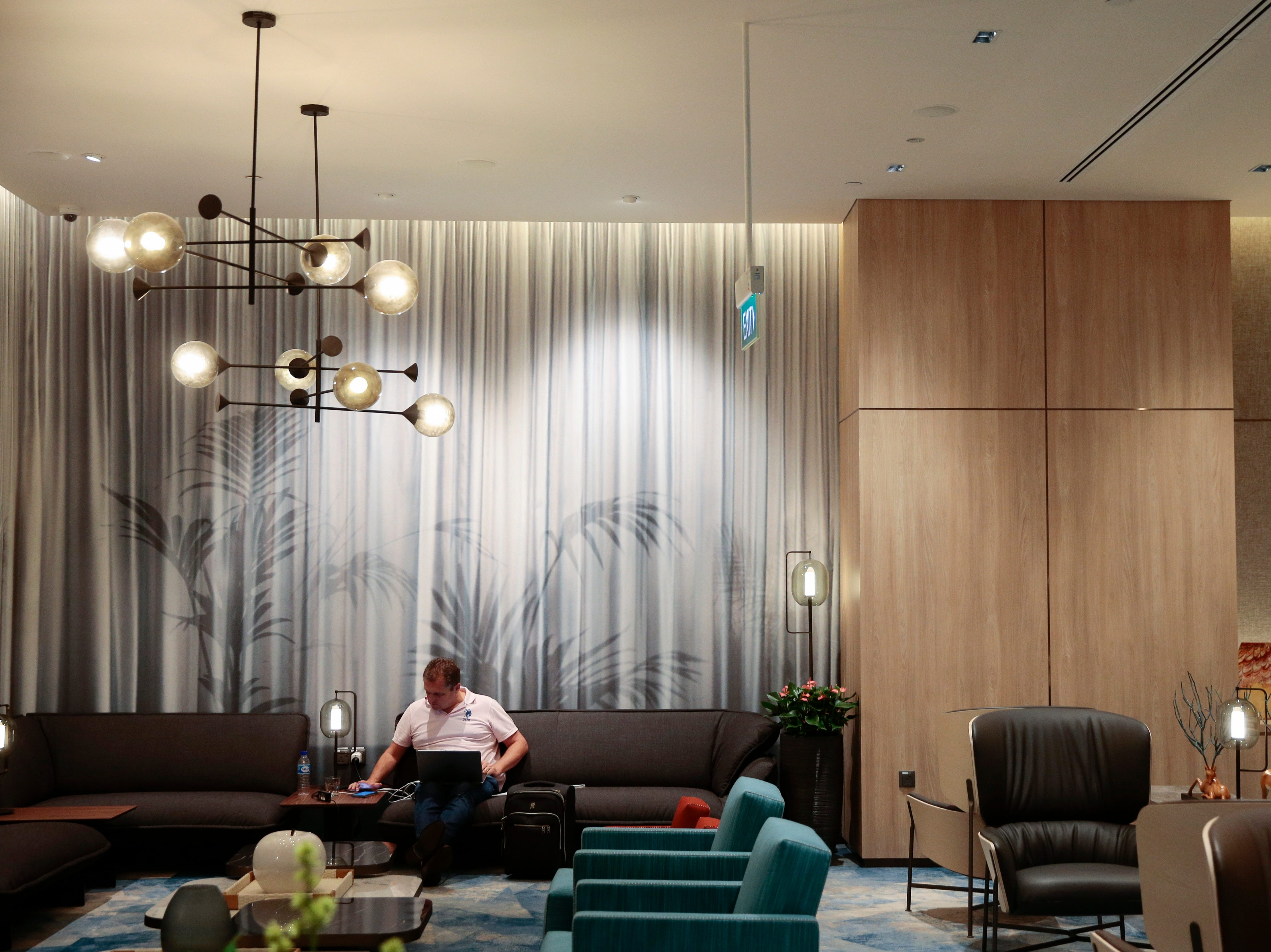 A man sits at the Changi Lounge at the  Jewel Changi during a preview of the airport. It opens to the public on April 17.