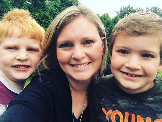 Pamela Perry saves all year to send her sons Ben, 6,(left) and Austin, 8 (right) to summer camp