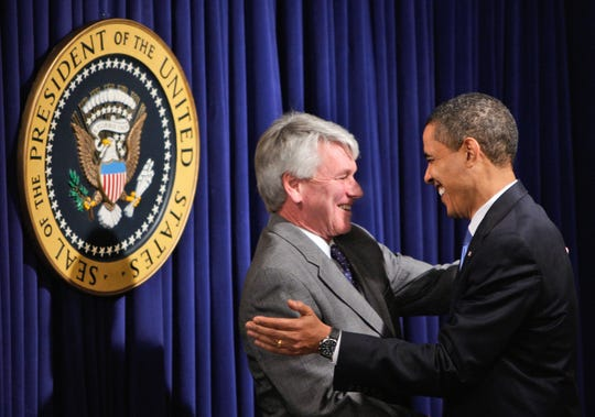 President Barack Obama talks with White House Counsel Gregory Craig, after Craig, and other White House staff members were sworn-in, Wednesday, Jan. 21, 2009, in the Eisenhower Executive Office Building in Washington.