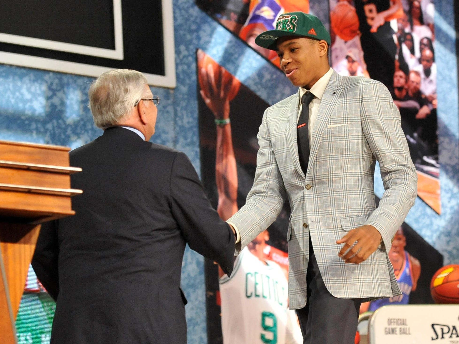 Antetokounmpo greets former NBA commissoiner David Stern on stage after being drafted by Milwaukee.