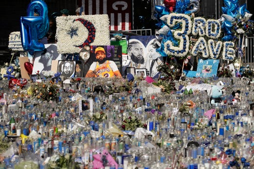 A makeshift memorial site for slain rapper Nipsey Hussle is filled with candles outside The Marathon Clothing store, April 11, 2019, in Los Angeles.
