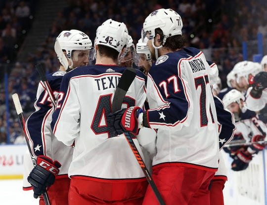 Columbus Blue Jackets left wing Nick Foligno (71) celebrates with teammates after scoring a goal against the Tampa Bay Lightning.