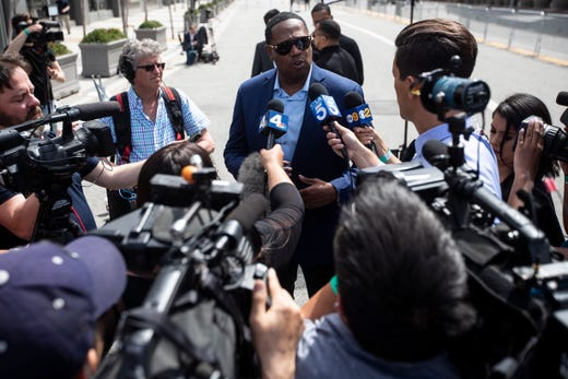 US rapper Master P answers questions from the media as he attends the ceremony 'Nipsey Hussle Celebration of Life' to honor the memory of the late rapper at the Staples Center Stadium in Los Angeles, April 11, 2019.