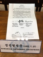 A copy of the 1953 armistice agreement that ended hostilities in the Korean War, displayed in a small museum at the DMZ.