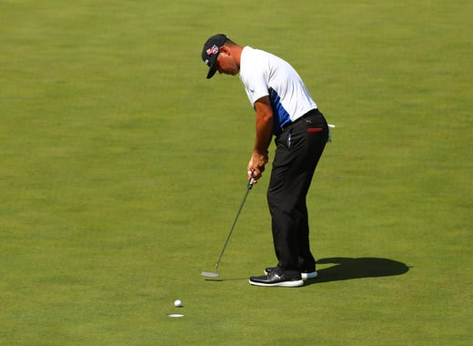 Gary Woodland putts on the 15th green during the first round of the Masters at Augusta National Golf Club.