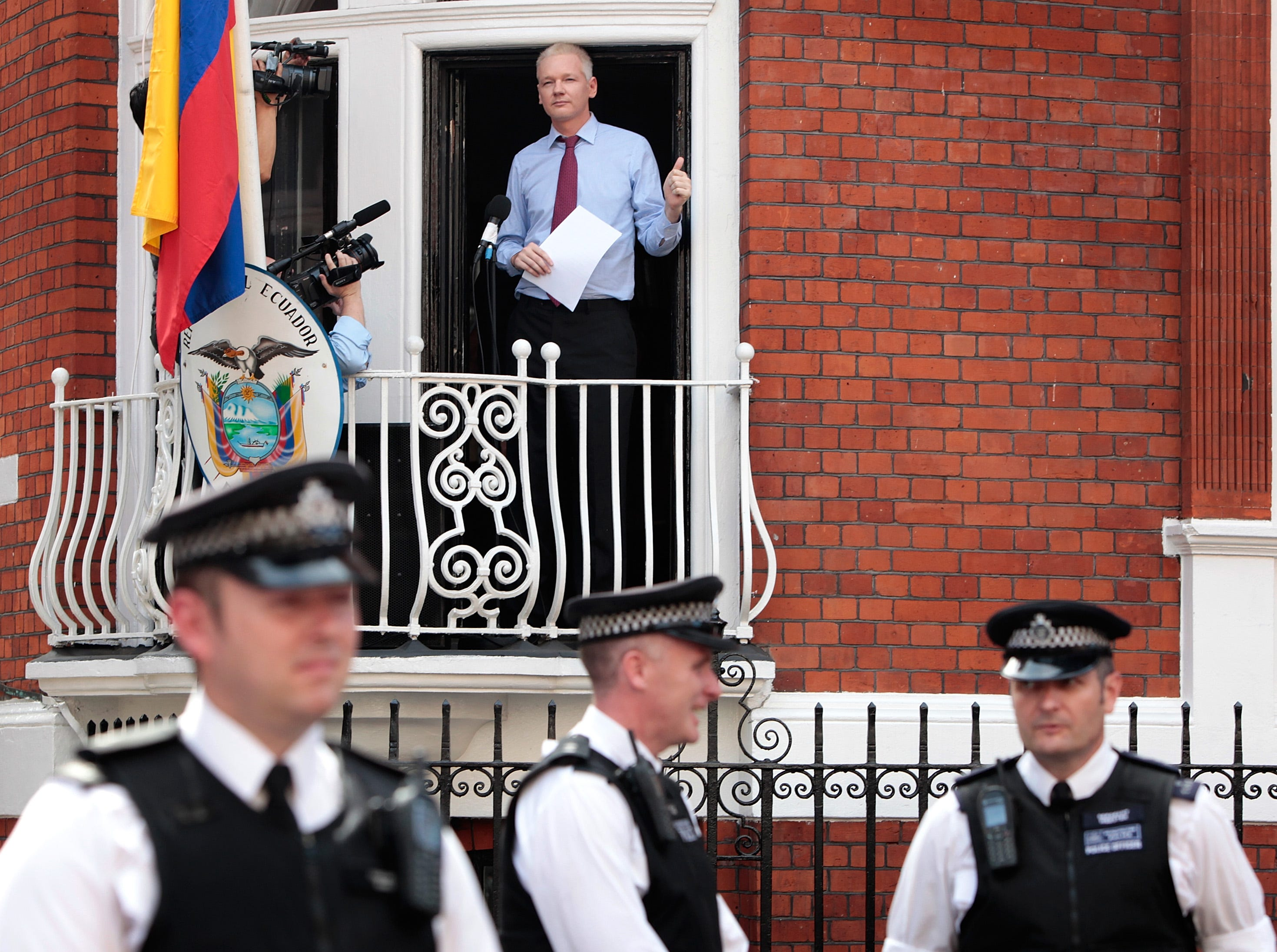 Julian Assange is seen on the balcony of the Ecuadoran embassy on August 19, 2012 in London, England. Assange, 47, took refuge in the embassy in 2012 to avoid extradition to Sweden for questioning over the rape allegations.