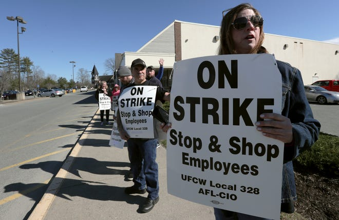 Union workers picket outside a Stop & Shop supermarket, Thursday, April 11, 2019, in Norwell, Mass., after workers walked off the job in Massachusetts, Rhode Island and Connecticut over stalled contract negotiations.