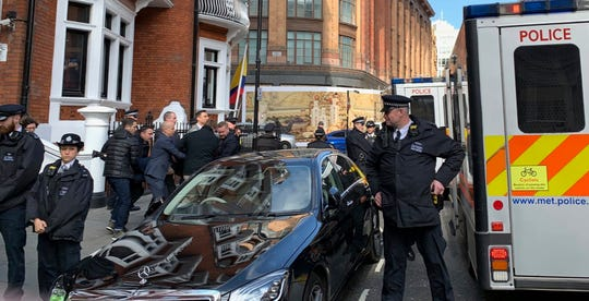 Police carry WikiLeaks founder Julian Assange from the Ecuadorian embassy in London after he was arrested by officers from the Metropolitan Police and taken into custody on April 11, 2019.
