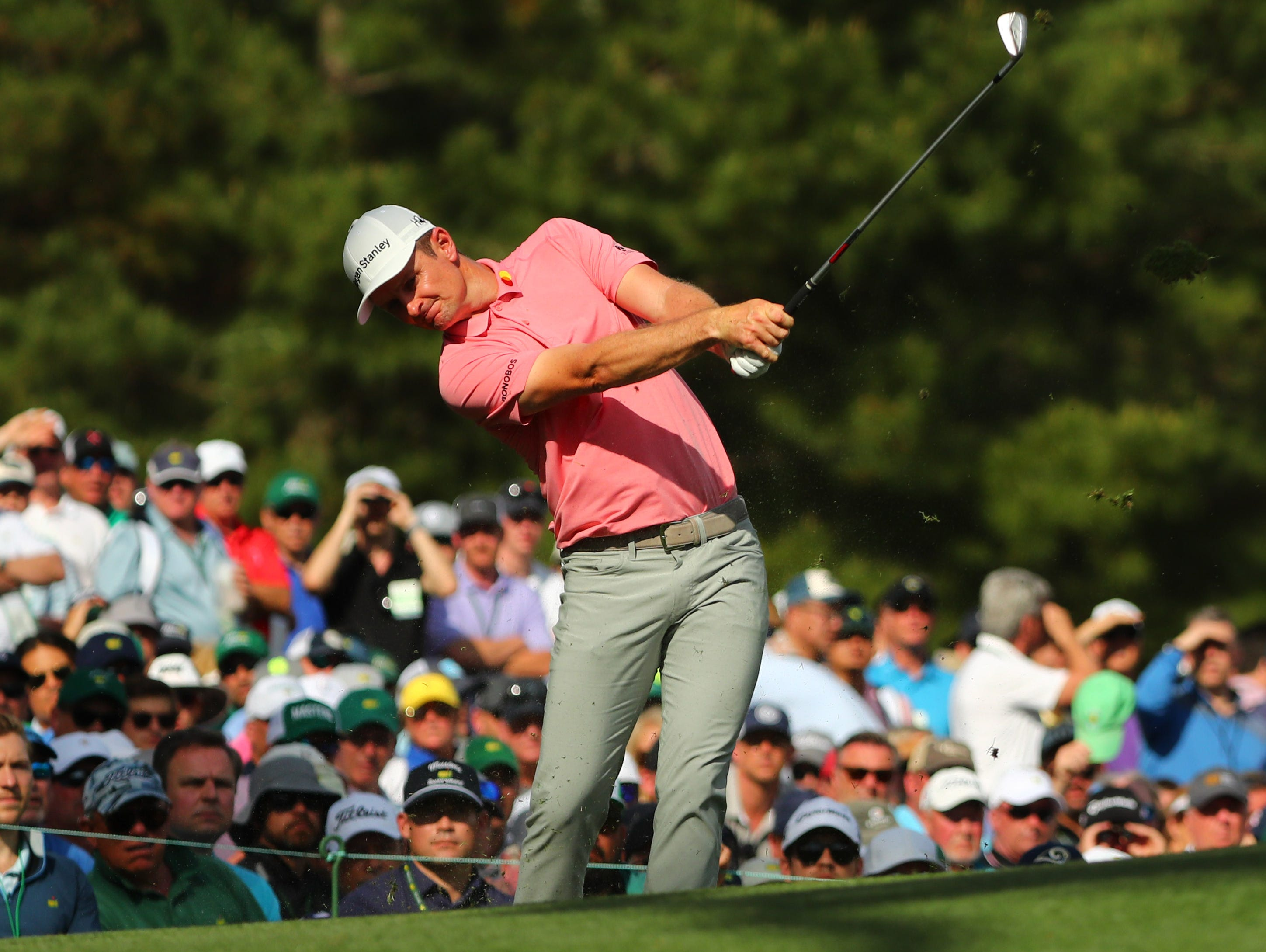 Justin Rose hits his tee shot on the 12th hole during the first round of the Masters.