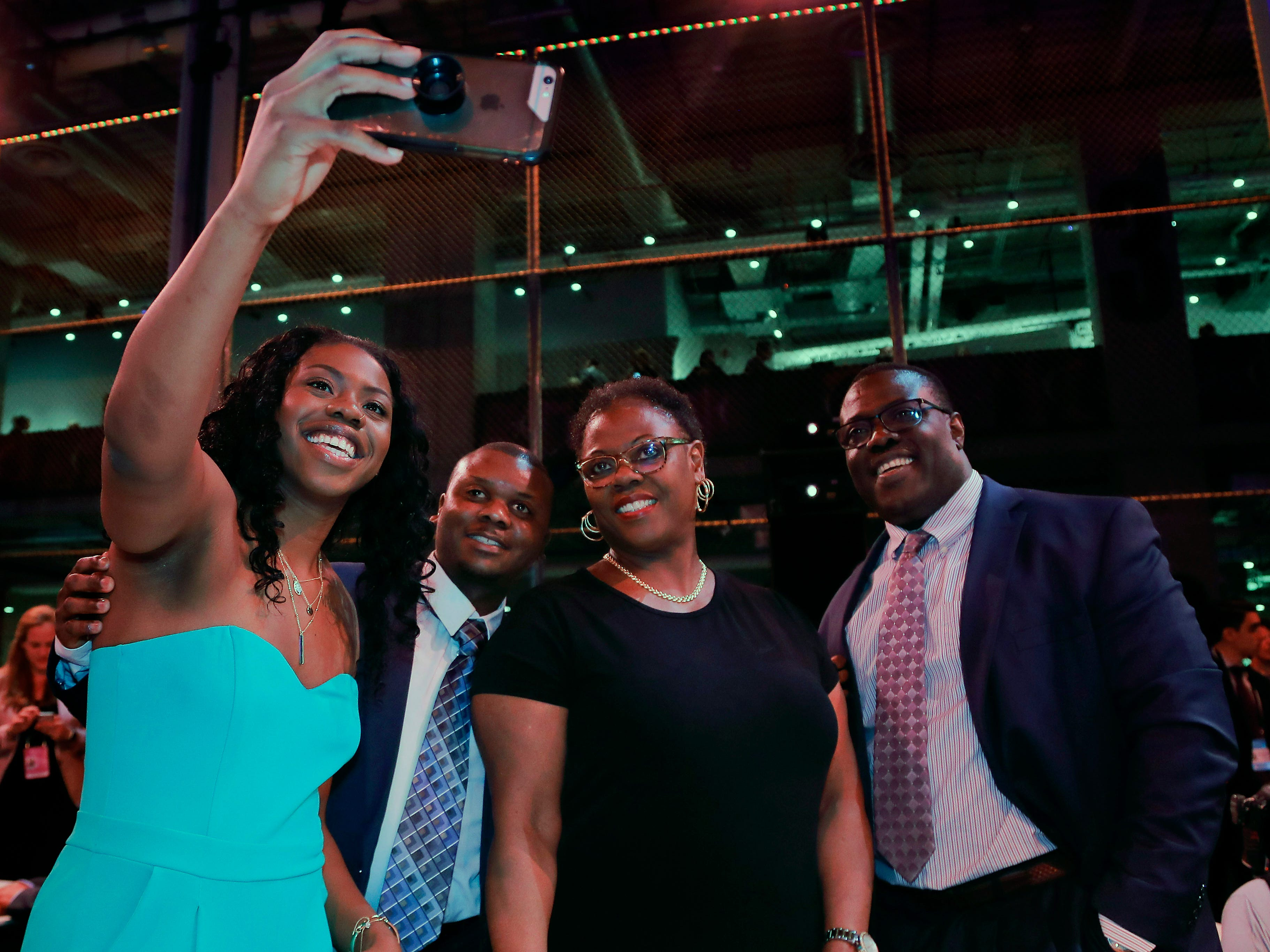 Arike Ogunbowale (left) takes a selfie with her family before the WNBA draft in New York.