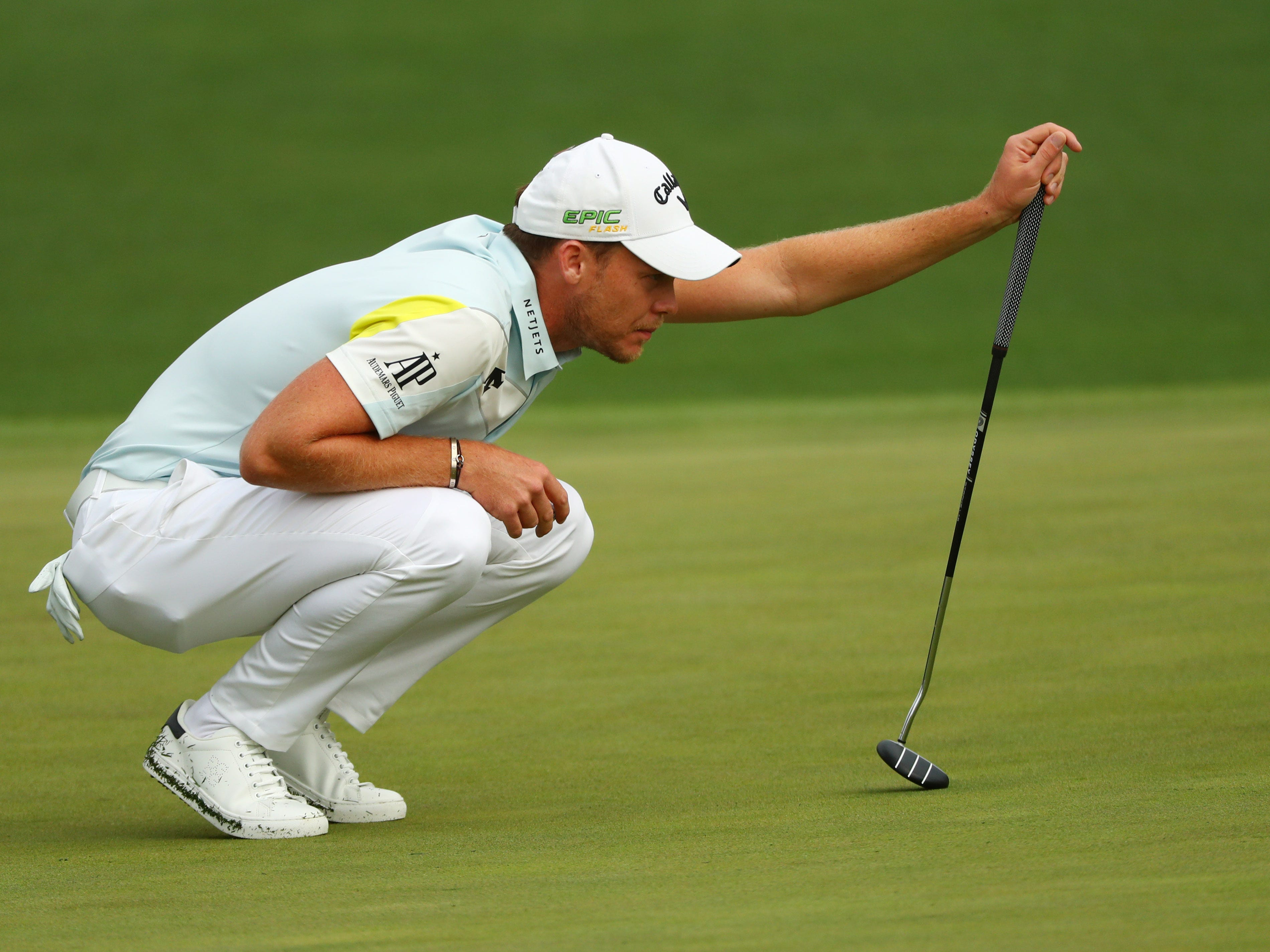 Danny Willett lines up a putt on the second green.