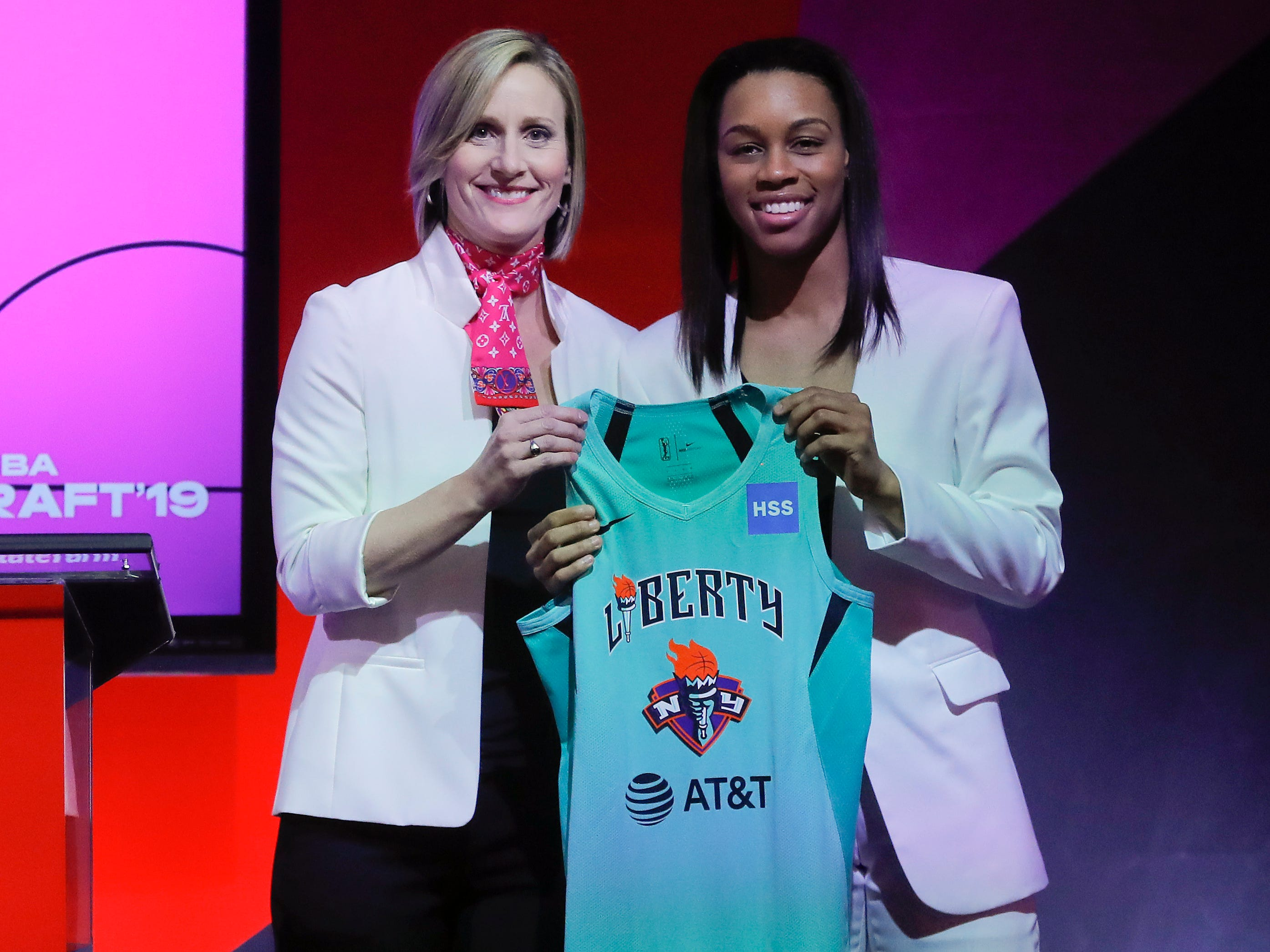 Louisville's Asia Durr poses for photo with WNBA COO Christy Hedgpeth after being selected by the New York Liberty as the second overall pick in the WNBA draft.