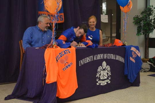 University Academy senior Tyler Carlin signs with Louisiana College Wednesday.
