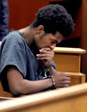Quaimere Mohammed becomes emotional as texts between him and girlfriend Jada M. McClain are read during his detention hearing Friday, April 12, 2019, in State Superior Court in Freehold.  Mohammed is charged with desecrating the remains of his infant son who was alledgedly killed by McClain.