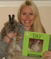 Jenna Flaherty with her record-setting rabbit Do, who lived until age 17