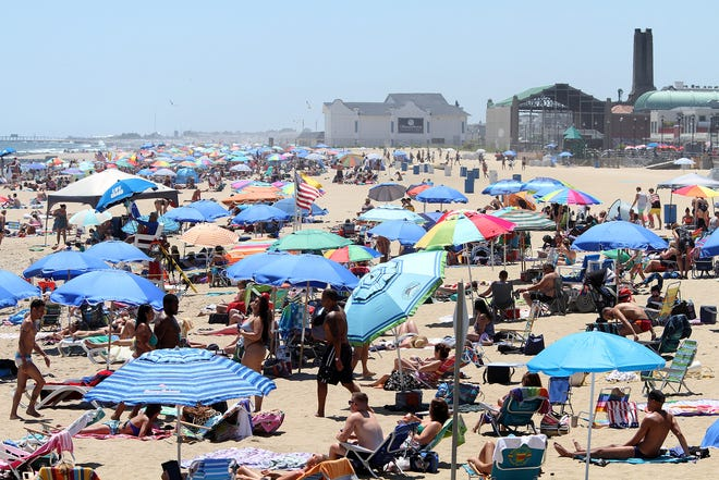 People fill the beach south of Convention Hall in Asbury Park last summer.