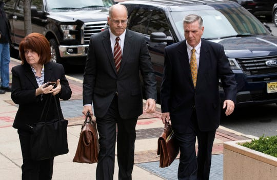 Ocean County Republican Chairman George Gilmore arrives at Federal Court in Trenton with his attorney and wife. He faces tax evasion charges.