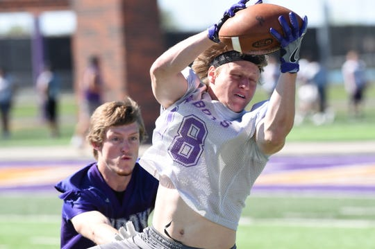Hardin-Simmons receiver Cale Nanny (18) hauls in a pass during spring practice.