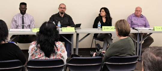 Abilene City Council Place 6 candidates, from left, Travis Craver, David Turvaville, Jessica Cantu and Charles Byrn had the opportunity to speak about community issues at Thursday evening's Hispanic Leadership Forum at the Mockingbird Lane branch of the Abilene Public Library. A fifth candidate, Ron Konstantin, was a no-show.