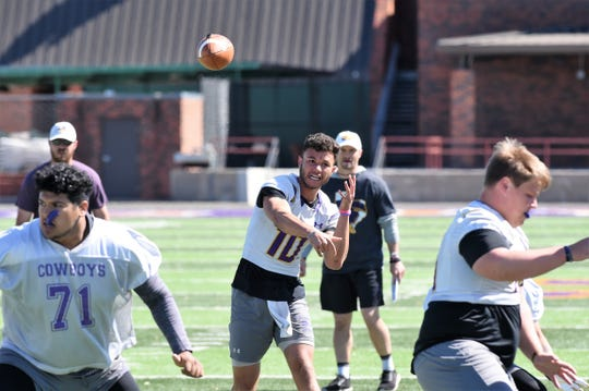 Hardin-Simmons quarterback Peyton Killam trows a pass during spring practice at Shelton Stadium on Thursday, April 11, 2019.