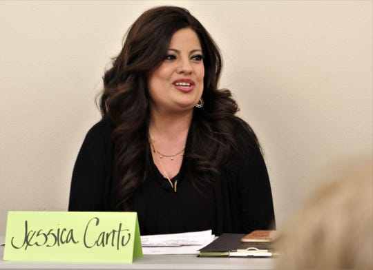 Abilene City Council Place 6 candidate Jessica Cantu smiles as she talks about herself during introductions at during the April 11 Hispanic Leadership Council forum.