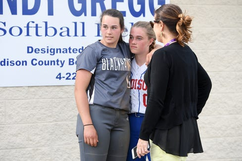 North Buncombe pitcher Caitlin Griffin and puts her arm around Madison pitcher Savannah Rice after their game at the Andy Gregg softball field in Marshall on April 11, 2019. The two have been best friends for years and will be playing together and not against one another at Western Carolina University after they graduate.