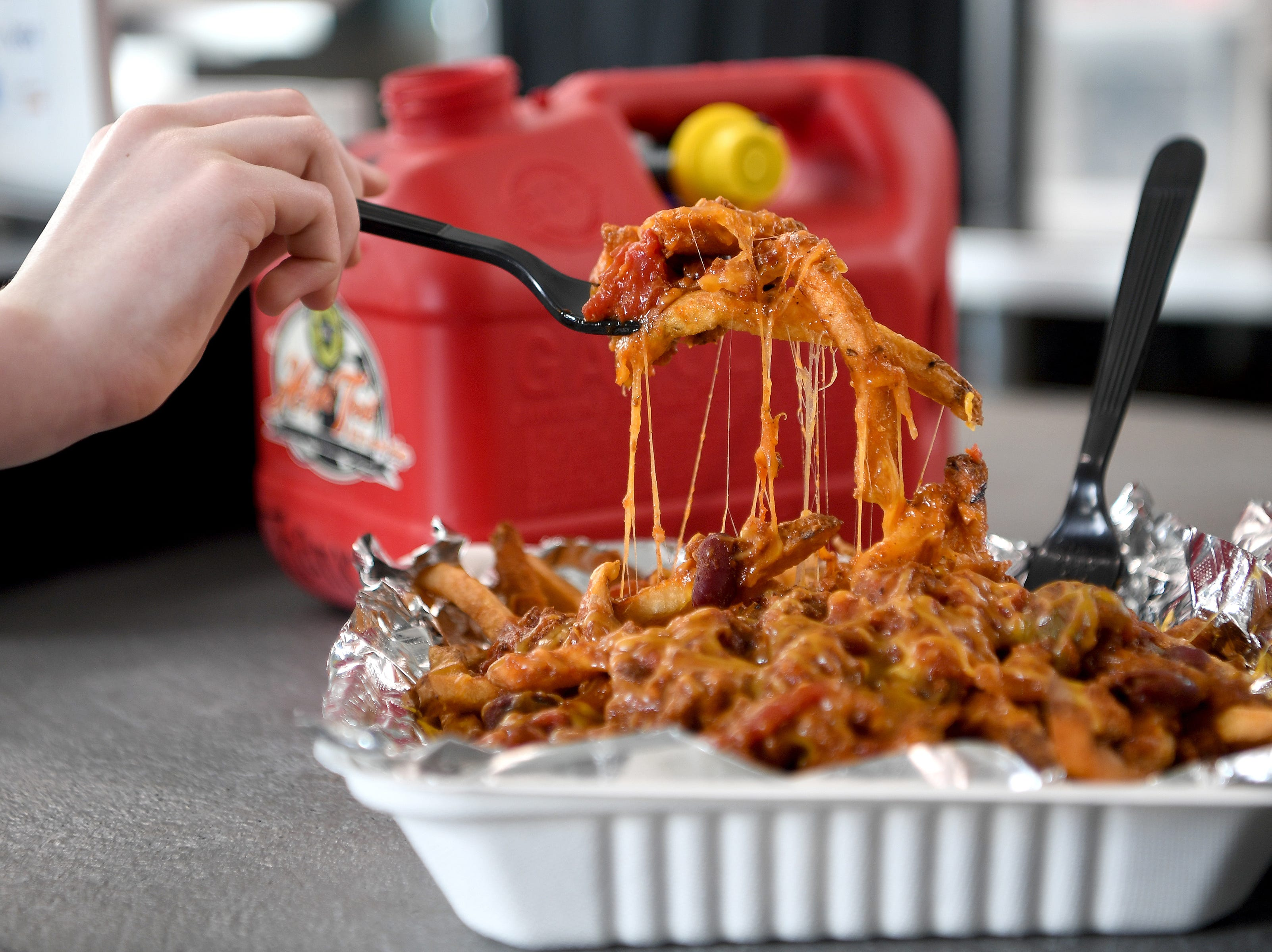The chili cheese fries at High Test Deli and Sweet Shop on the South Slope are smothered with toppings and feed at least two people.