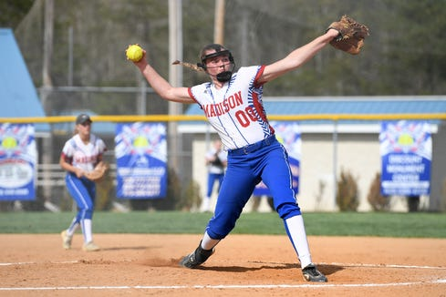 Madison pitcher Savannah Rice delivers a pitch against North Buncombe during their game at the Andy Gregg softball field in Marshall on April 11, 2019. The Lady Patriots defeated the Lady Blackhawks 6-4.