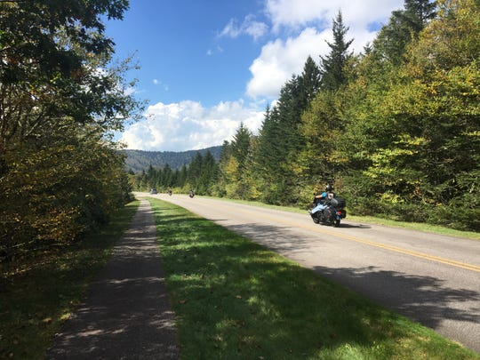 A motorcycle cruises the Blue Ridge Parkway last year in the Devils Courthouse area.
