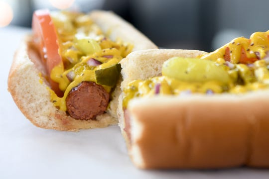 The Chicago dog is one of several footlong all-beef kosher hotdog choices at High Test Deli and Sweet Shop on the South Slope. It is topped with onion, tomato, pickles, sport peppers, celery seasoning, yellow mustard and relish.