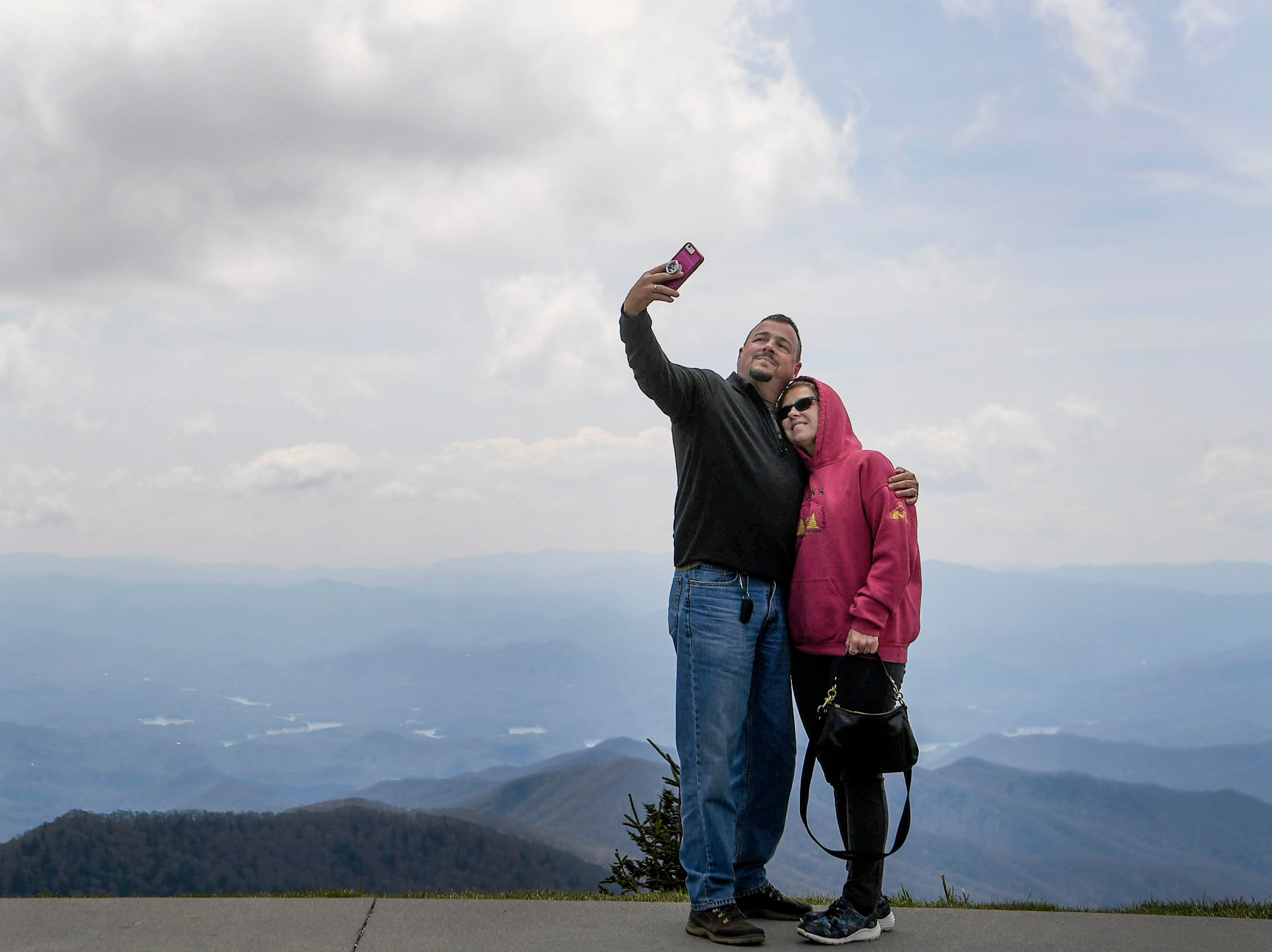 Ronnie and Tammy Cook, of Smyrna, Georgia, take a photo in the parking lot of Clingmans Dome in Great Smoky Mountain National Park April 10, 2019.