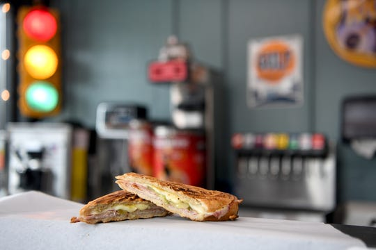 The High Test at High Test Deli and Sweet Shop on the South Slope is a Cuban sandwich made with ham, Cuban pork, salami, Swiss cheese, pickles, spicy mustard and served on Cuban bread hot pressed with garlic butter.