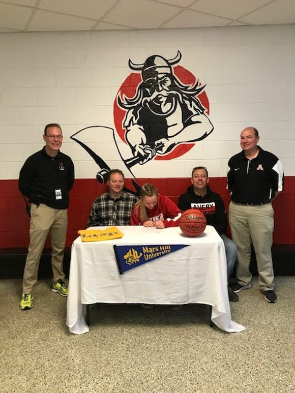Avery County senior Heaven Nelson signs with Mars Hill on Friday, April 12