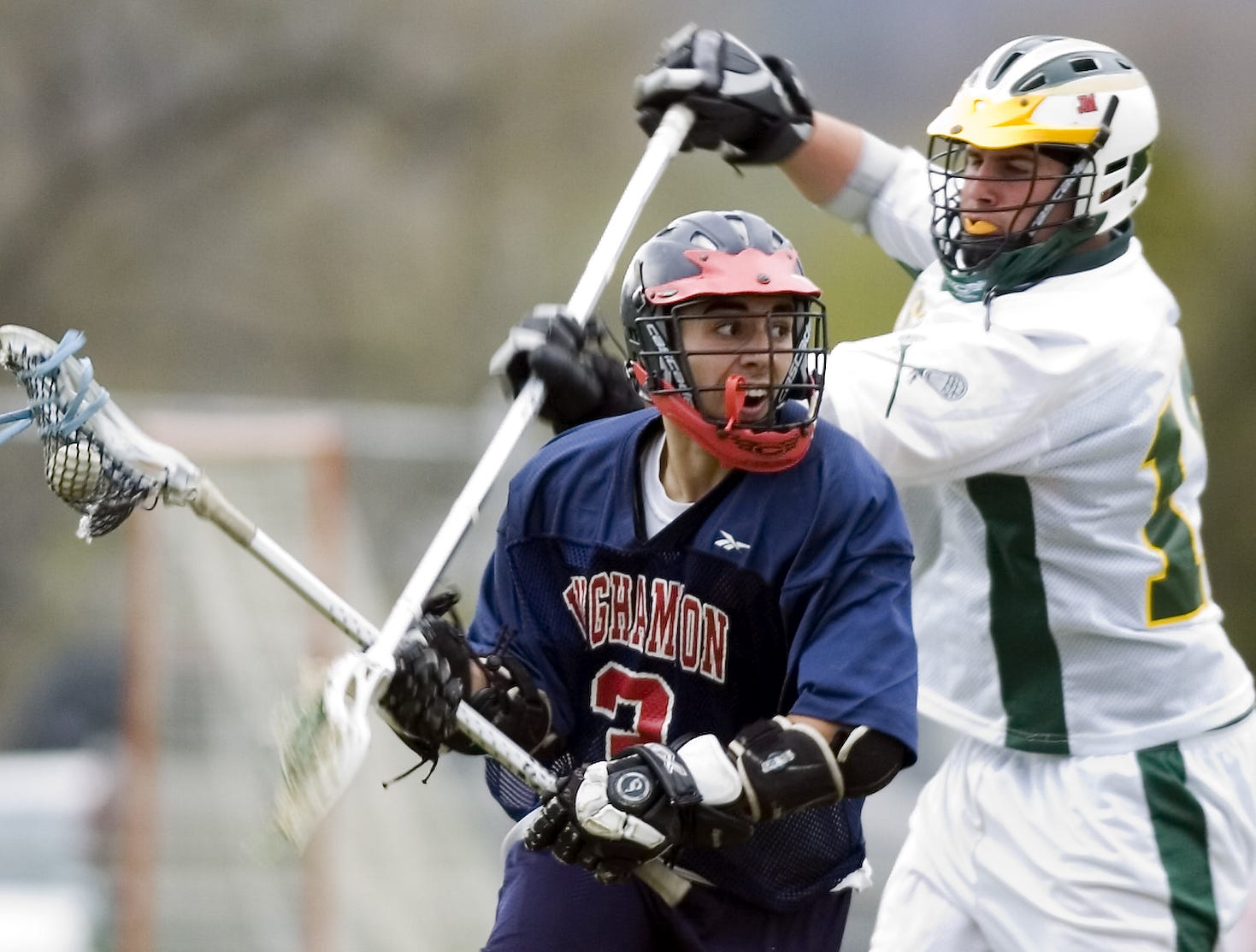 2007: Binghamton High School's Cory Campon, left, is defended by Vestal High School's Jeff Battaglini in the second period of the Tuesday lacrosse game in Vestal.
