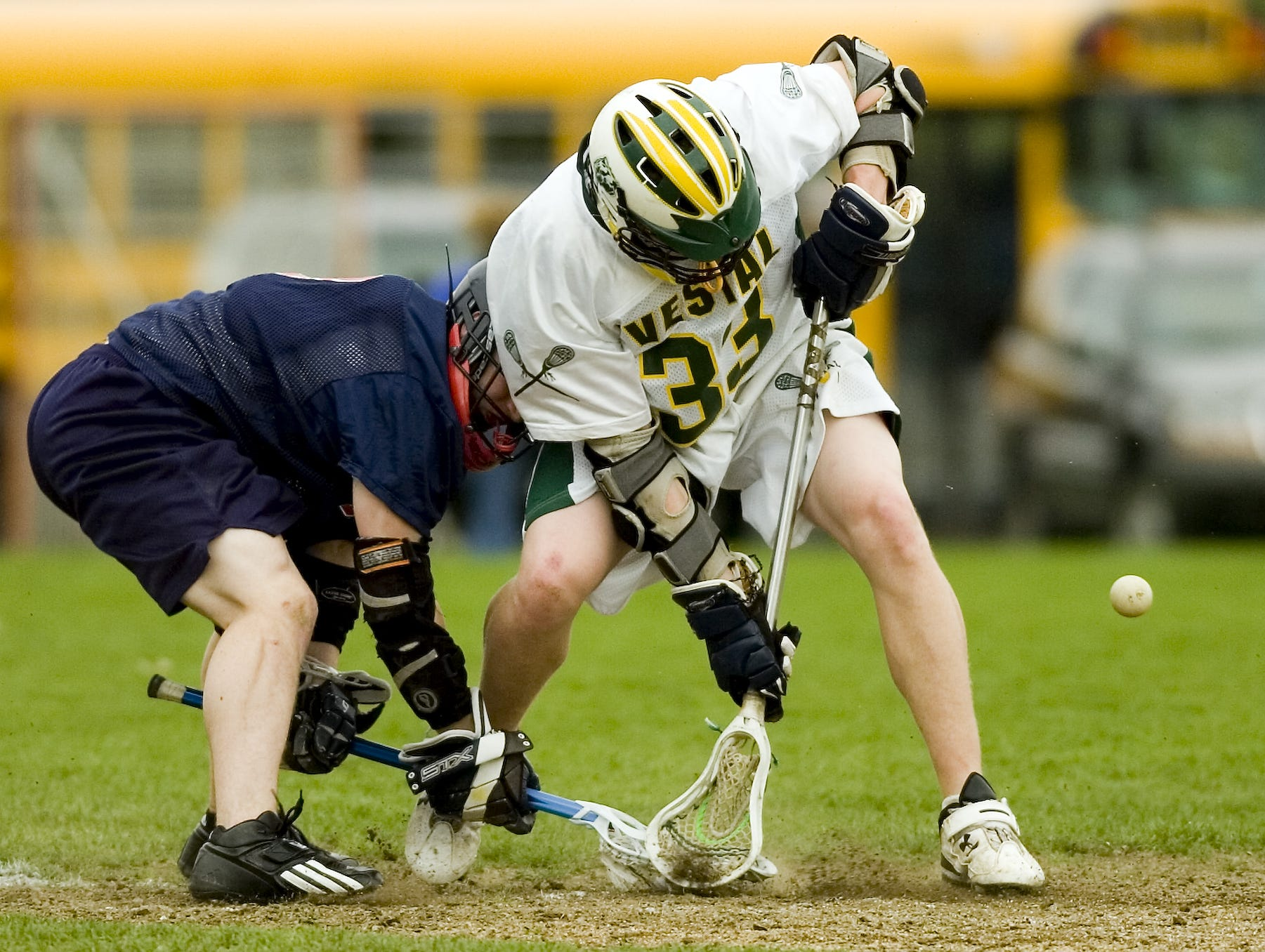 2007: Vestal High School's Chris Cook, right, and Binghamton High School's Casey Berry enter the second period of play during the Tuesday lacrosse game in Vestal.