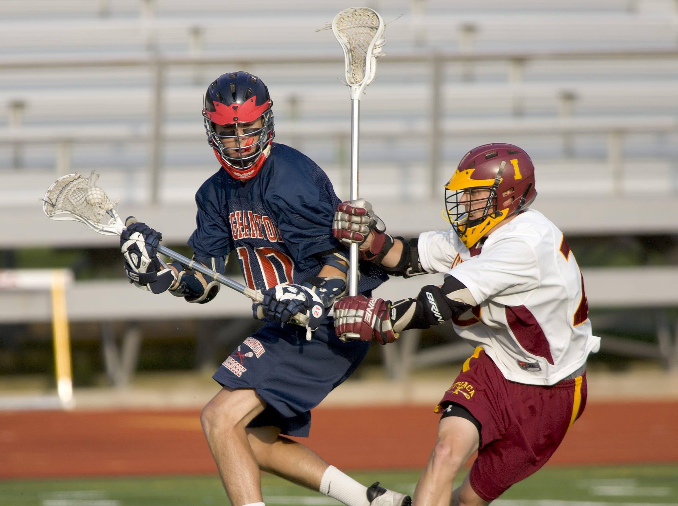 2009: Binghamton's James McAuliffe battles Ithaca's Benjamin Chase on Tuesday evening at Ithaca High School.