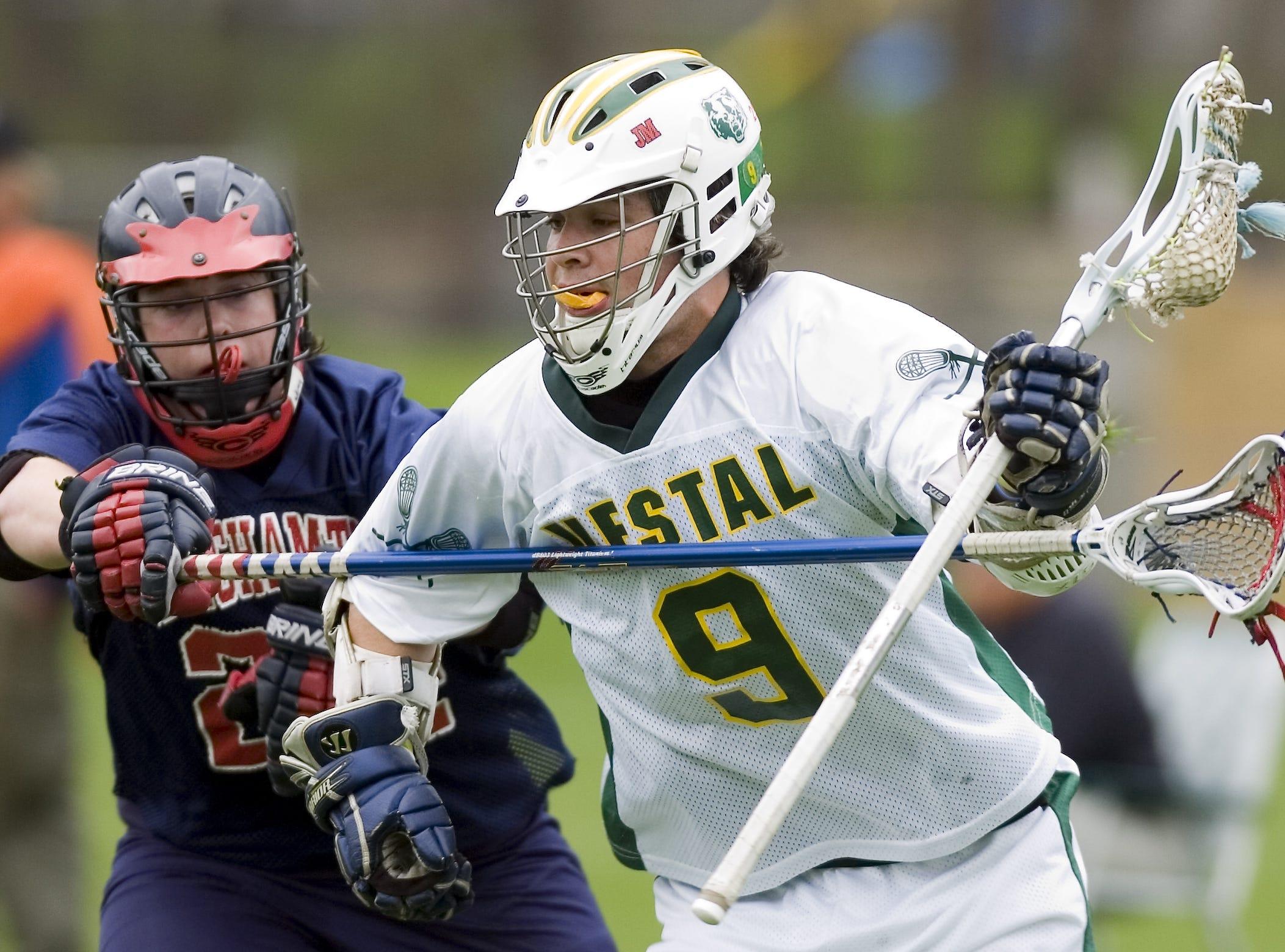 2007: Vestal High School's Travis Harrington, right, works past Binghamton High School's Pat Joyce in the first period of the Tuesday lacrosse game in Vestal.