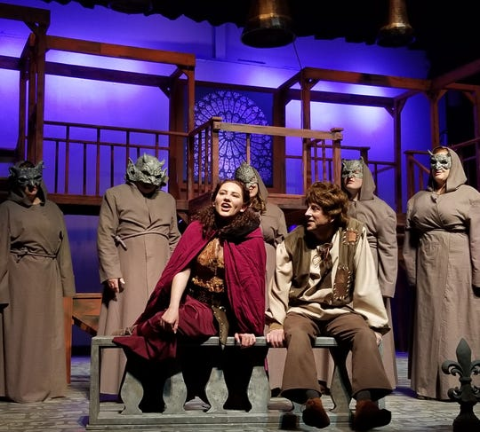 """Esmerelda (Dalton Alden-Welfl Brillhart, left) entertains Quasimodo (Eric Spencer) and the gargoyles in BCT's production of """"The Hunchback of Notre Dame,"""" which has its final weekend of performances May 3-5."""