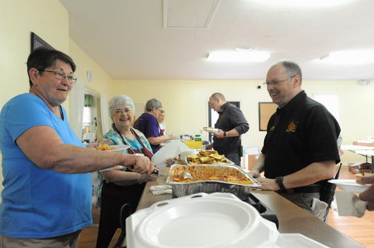 Black Mountain deputy fire chief John Wilson picks up a plate of spaghetti at the Hand In Hand fundraiser on April 5.