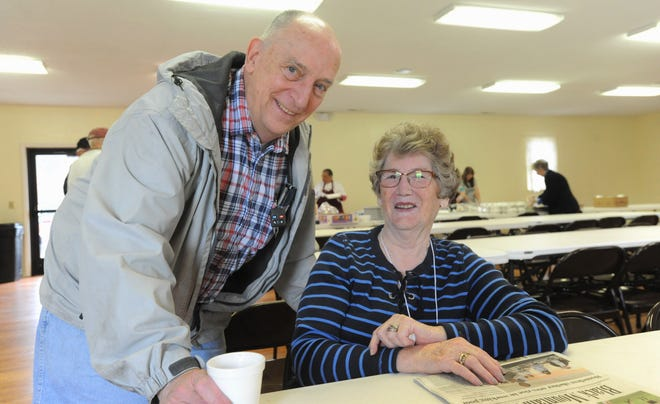 Hand In Hand founder Lois Nix and member Jon Hopkins were among dozens of volunteers at the organization's spaghetti lunch at Grove Stone Baptist Church on April 5. The event raised money for schools in the Owen District.