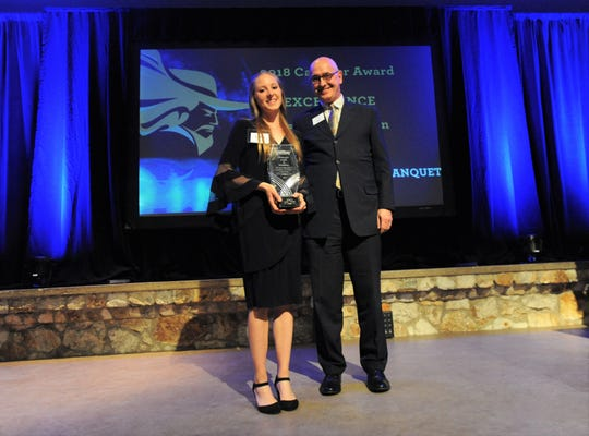Four-time All-American runner Lydia Wilson receives the 2018 Cavalier Award of Excellence from Montreat College president Paul Maurer in the Upper Anderson Auditorium on April 12.
