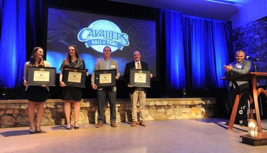Montreat College athletic director Jose Larios recognizes Cavaliers Hall of Fame members who attended the Cavaliers Court of Excellence banquet on April 12.