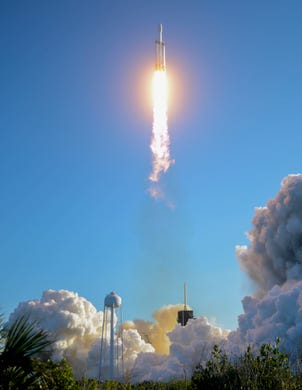 A SpaceX Falcon Heavy takes off from Pad 39A at the Kennedy Space Center on Thursday night. The rocket carries the communications satellite Arabsat 6A for Saudi Arabia.