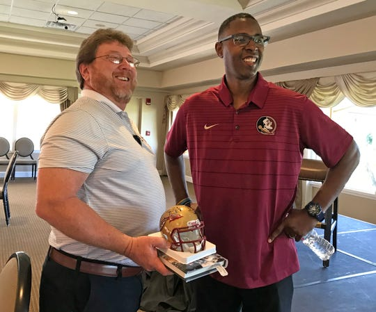Paul Chinaris of Cocoa was all smiles after getting his helmet autographed by 1993 Heisman Trophy winner Charlie Ward, who was the Brevard Seminole Club's featured speaker at Suntree Country Club on Thursday night.