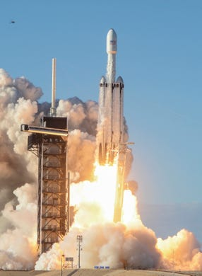 A SpaceX Falcon Heavy takes off from Pad 39A's Kennedy Space Center on Thursday night. The rocket carries the communications satellite Arabsat 6A for Saudi Arabia.