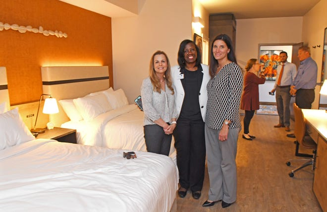 A sneak peek tour shows what rooms will look like at the Hotel Melby, which plans on breaking ground in June for a 2020 opening in downtown Melbourne. Pictured are  Melbourne Vice Mayor Debbie Thomas, Councilwoman Yvonne Minus and Shannon Lewis, city manager.