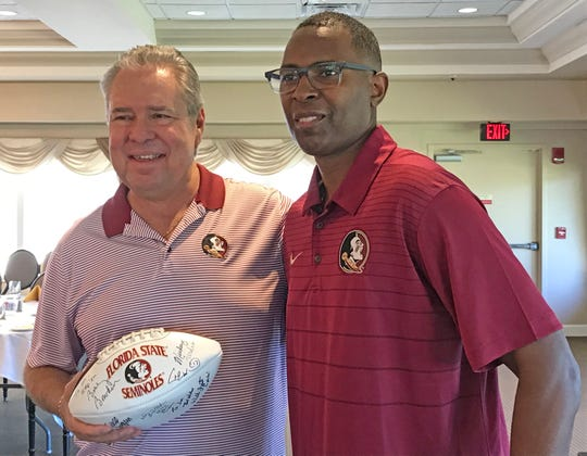 Jim Bowen of Port St. John is all smiles after getting his football autographed by 1993 Heisman Trophy winner Charlie Ward, who was the Brevard Seminole Club's featured speaker at Suntree Country Club on Thursday night.
