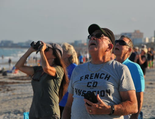 "Ed Valenti observes the rocket's head within easy reach. The people on the beach at the north end of Cape Canaveral got a great view of the take-off and landing of SpaceX Heavy launched by Launch Pad 39A at the Kennedy Space Center on Thursday night at 18:35. The rocket carried the communications satellite Arabsat 6A. The side boosters landed at the Cape Canaveral Air Force Station and the core booster landed on the drone ship ""Of course I still love you""."