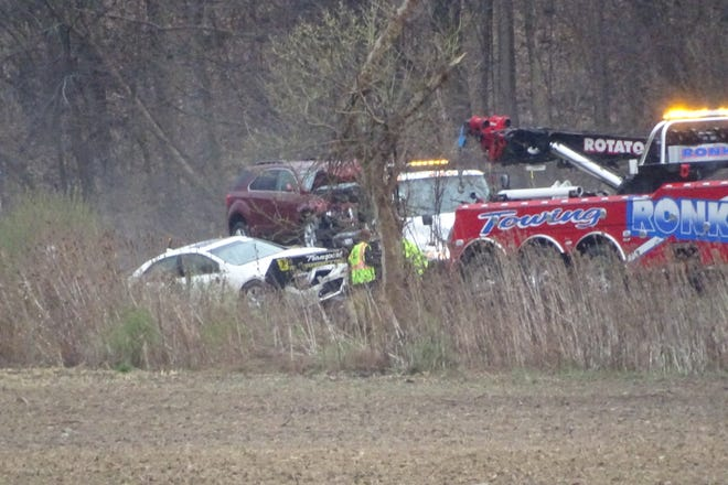 Crews work to remove vehicles from the water after a crash on U.S. 30 Friday morning.